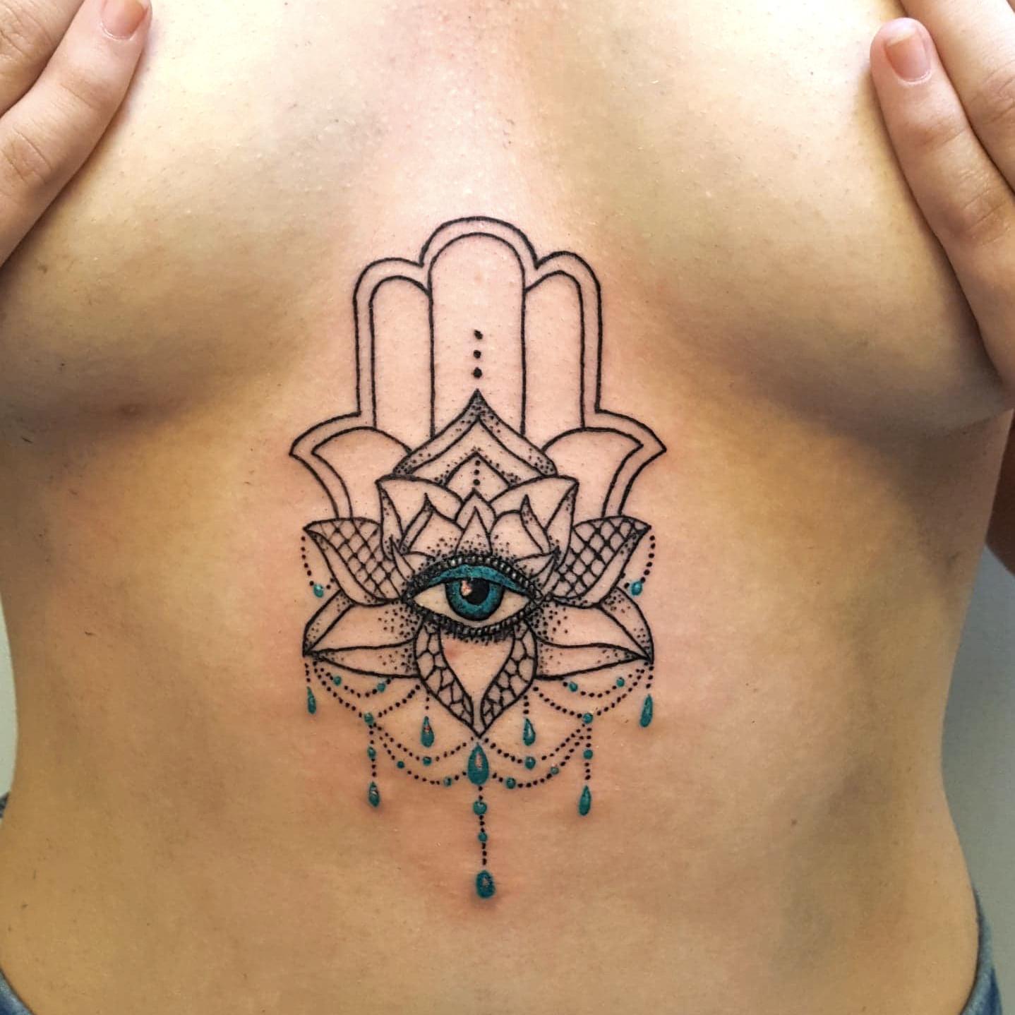 66391c687 Hamsa hand chandelier sternum tattoo