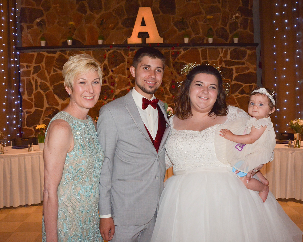 Dianna Anderson, Evan and Liz Anderson with their niece/flower girl.