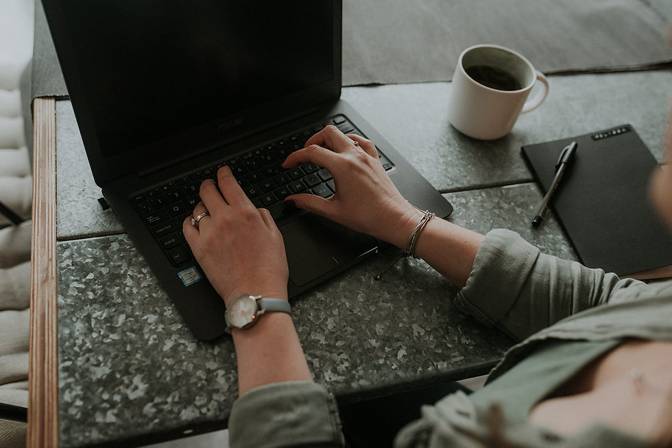 Melissa sat at her computer, the image is zoomed into her typing hands