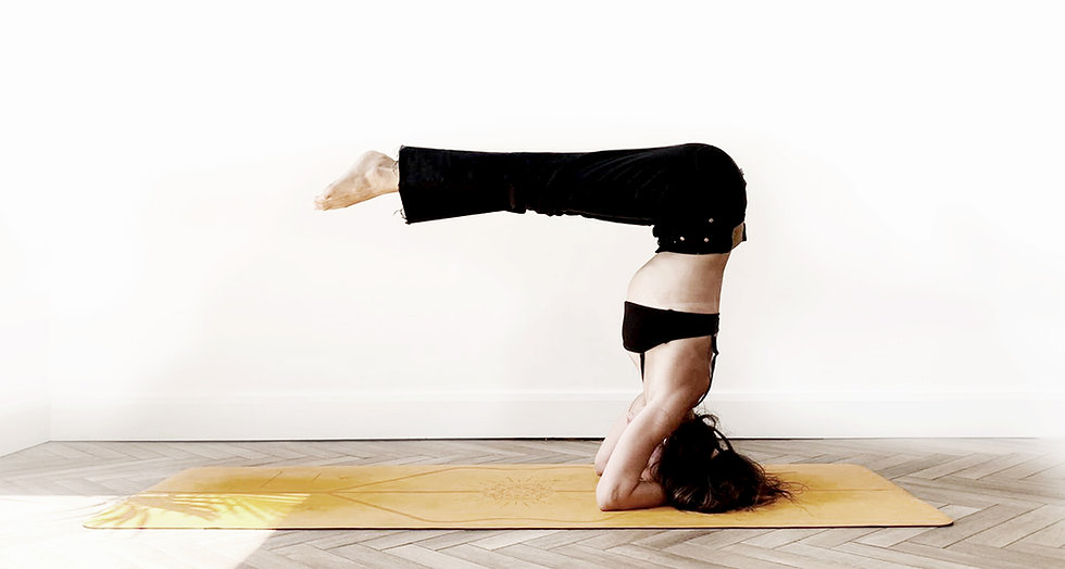Terri doing a variation of the pike headstand yoga pose