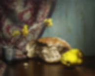 quince, bread, yellow flowers and a japanese teacup on a wooden table. There is an indian cotton fabric in thebackground, partly covering the turquise wooden wall. Bread crums. This painting is classical and academic. Painted in Barcelona Academy of art, Spain. It is oil on linen.