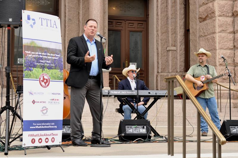 Dan Decker, Texas Travel Industry Association COO, singer Gary P. Nunn and guitarist Derek Groves kick off the What I Like About Texas campaign at the Texas State Capitol on May 26. (Courtesy photo/Texas Travel Industry Association)