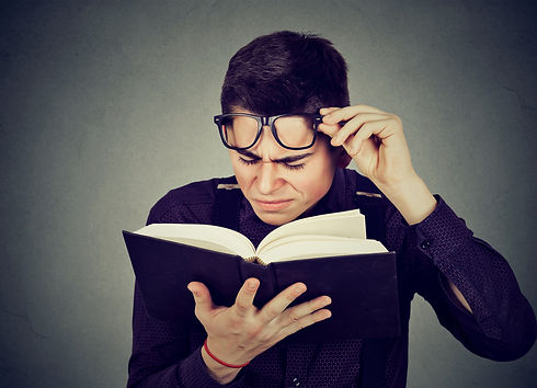 young man struggles to rrad book lower r