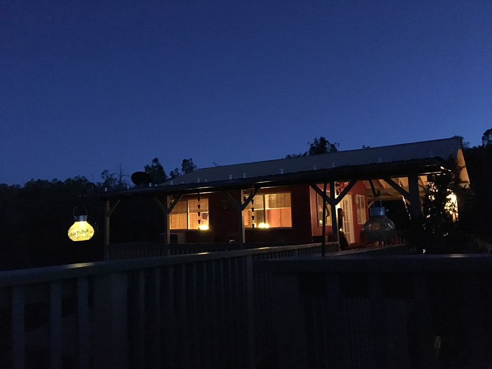 The view of the Bunkhouse at night from the Star Tower