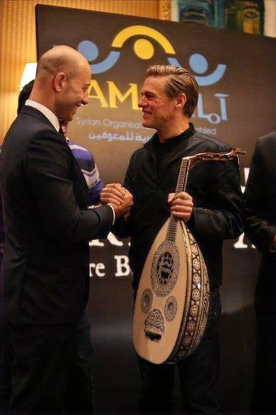 Feras and Bryan Adams were proud to be ambassadors for AAMAL, Syrian Organisation for the Disabled, where they were able to arrange and host a concert with Bryan Adams performing. It was a hard undertaking but completely worth it. Feras stated that he had a great deal of respect for Bryan Adams and he was given this Syrian instrument as a thank you gift.