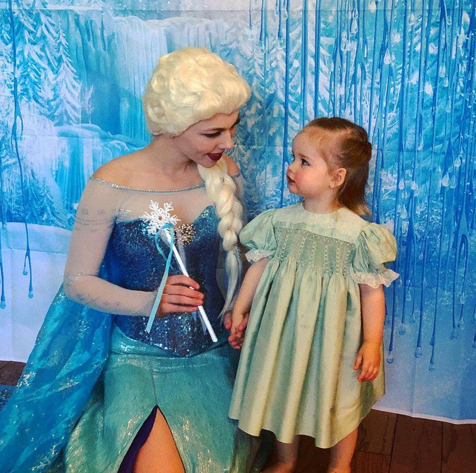Snow Queen with little girl