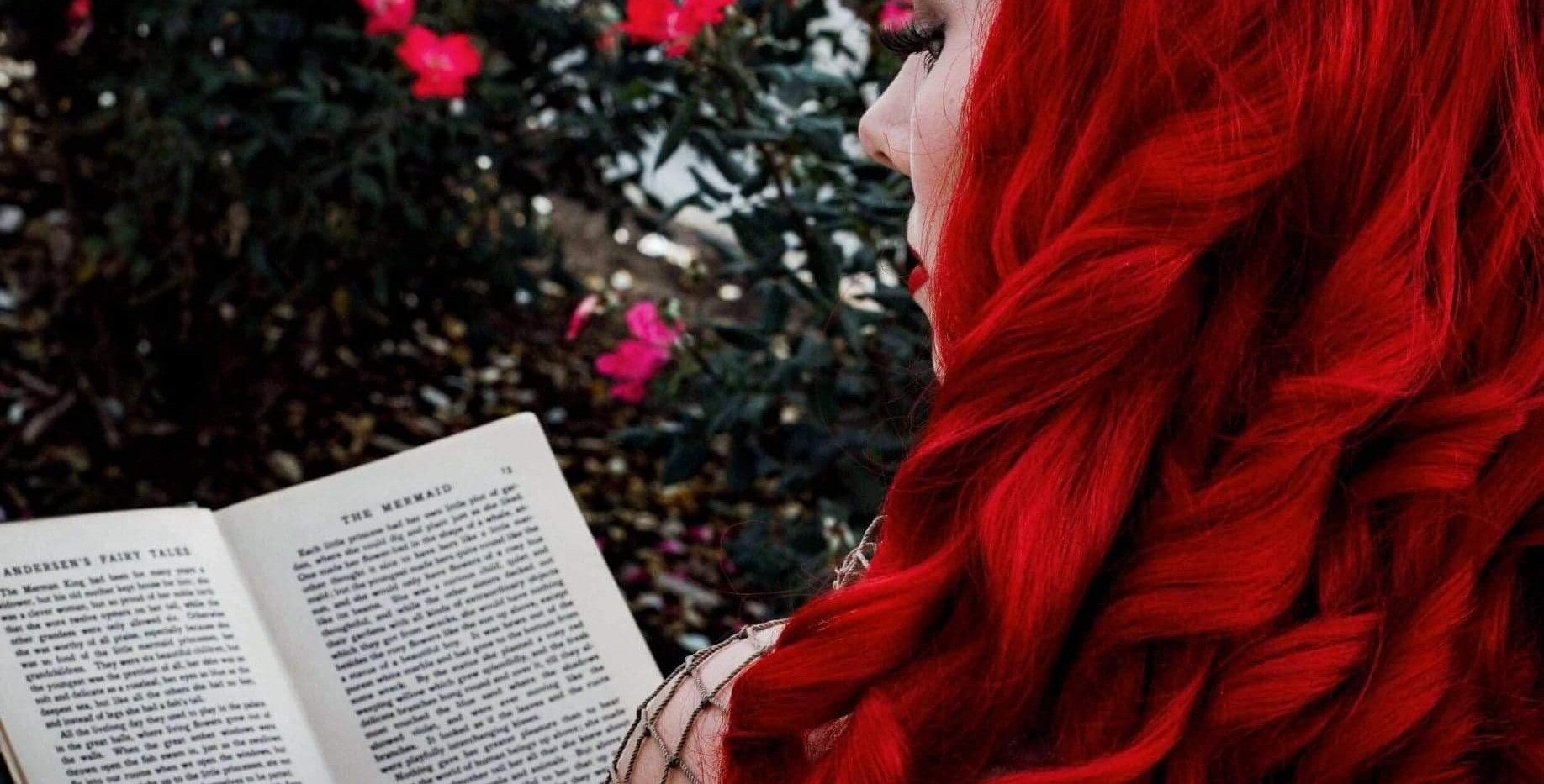 Little Mermaid reading a book