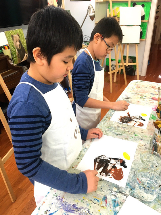 Tommy & Daniel paint side-by-side in Art Central's Semi-Private art classes