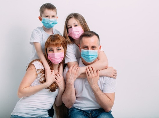 young-family-medical-masks-during-home-q