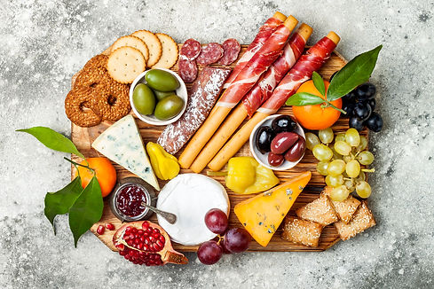 Appetizers table with antipasti snacks.