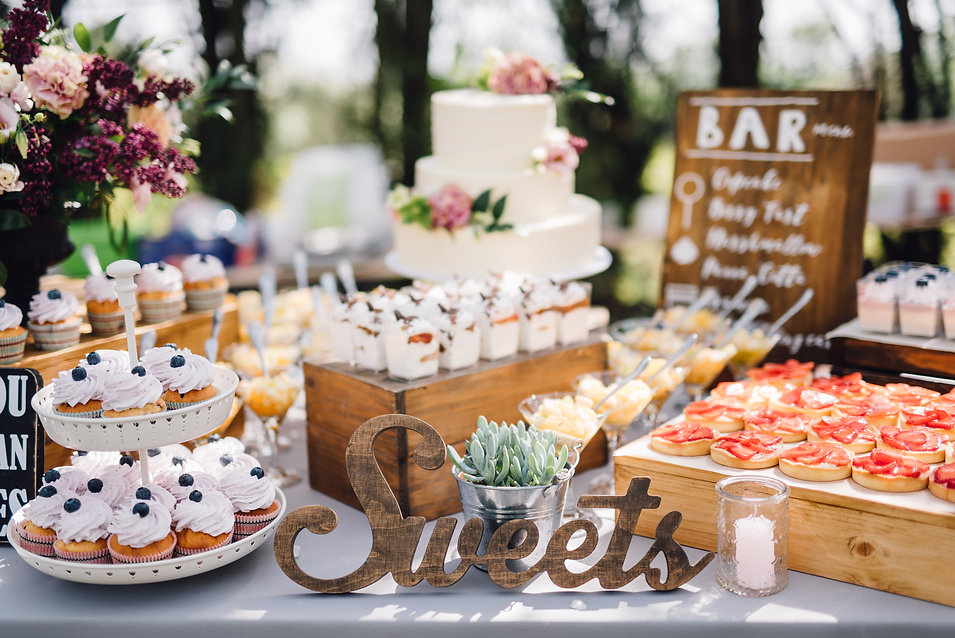 Handmade wooden Sweets sign standing in