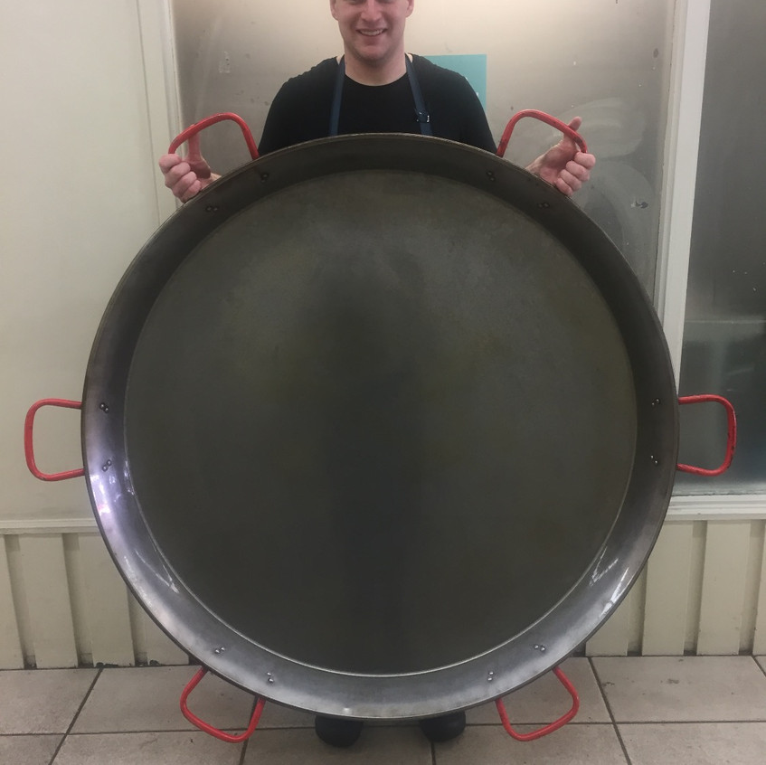 Our 1.30 meter paella pan capable of feeding 150 people. It only works out at $16.00 per head and includes bread and salad.
