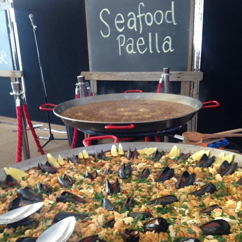 Our seafood paella and chicken and chorizo paella in the background. 2 x 90cm pans allows our clients to serve 100 people.