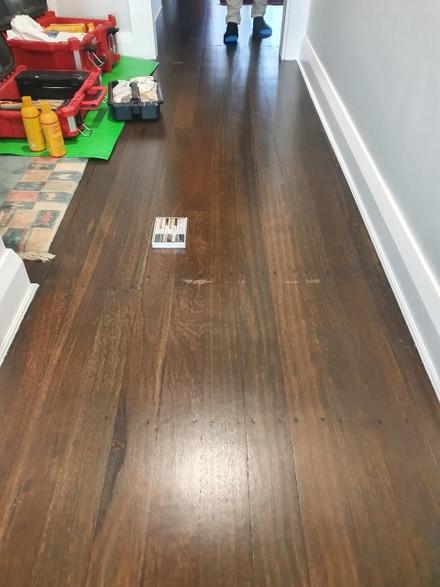 Bleached Jarrah wood flooring tape peeled marks - Before