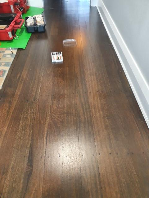 Bleached Jarrah wood flooring tape peeled marks - After