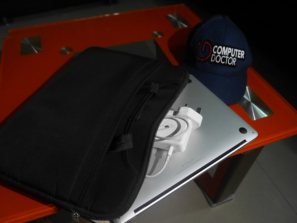 How to pack your MacBook in Folder Bag, make sure the charger is on the back side of the laptop.