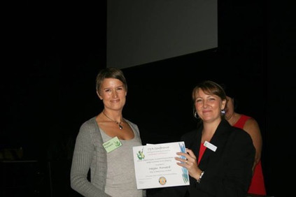 Megan accepting her prize at 201