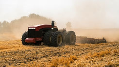 Autonomous tractor working in the field.