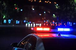 police car at night in street.jpg