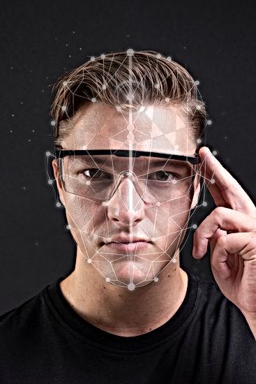 Cool man wearing smart glasses futuristi