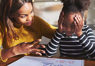 Frustrated child learning to calculate,