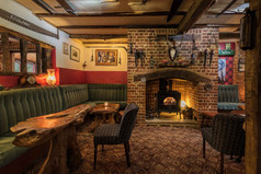 Warm and comfortable bar next to the real fire