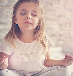 Little girl doing yoga in bed. .jpg