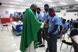 Male students receive token of committme
