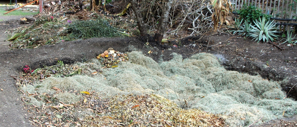 3 compost pits lined up close to each ot
