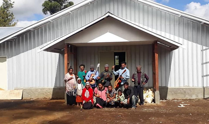 Parishioners posing in front of the new