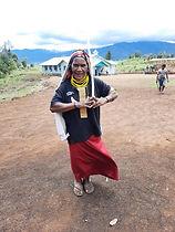 A happy parishioner with new church bui
