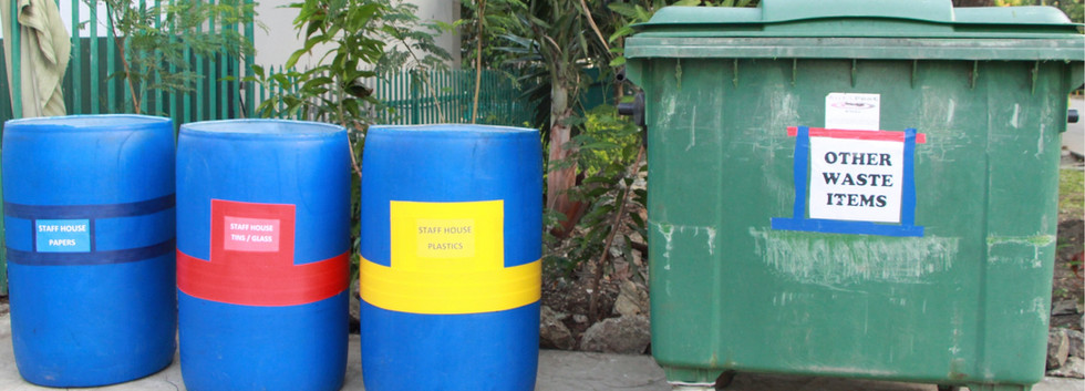 Recycling bins in front of the Staff Hou