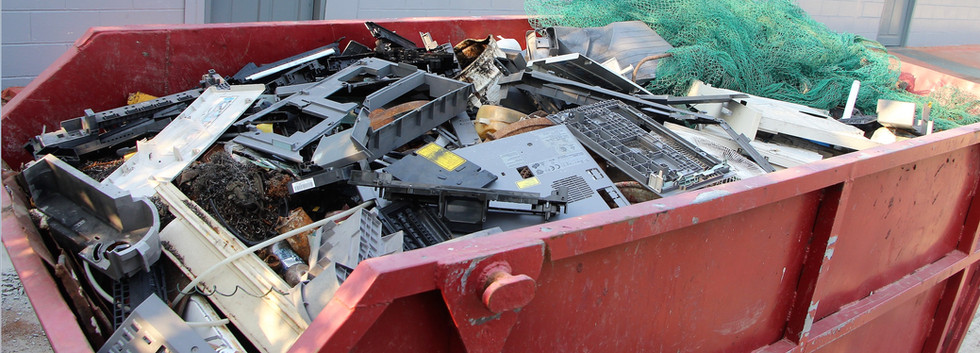Large metal skip bin to collect assorted