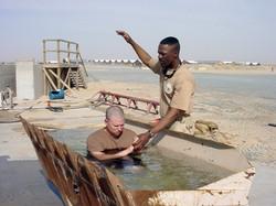 Baptism_in_a_front-end_loader