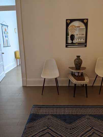 The waiting area at Hidden Root Acupuncture featuring two chairs and a side table