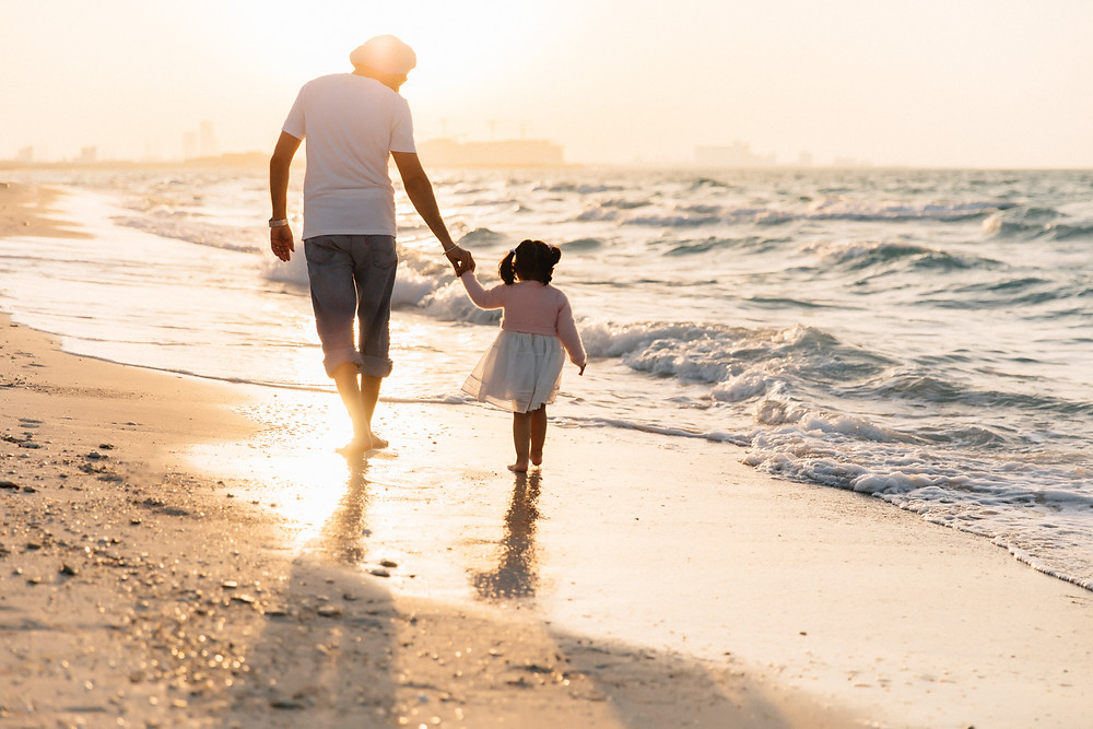 Karen Holden Photography; Abu Dhabi Family Photographer; Daddy and Daughter holding hands