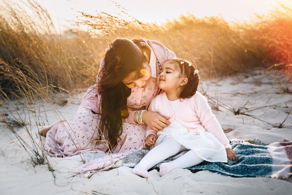 Karen Holden Photography; Abu Dhabi Family Photographer; A little cuddle in the sea grass