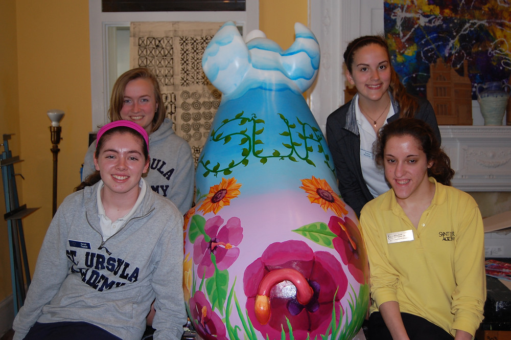 The proud artists pose with their prided pig, Petunia.