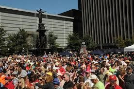 A crowd gathers in Fountain Square at the main stage for the Chicken Dance.