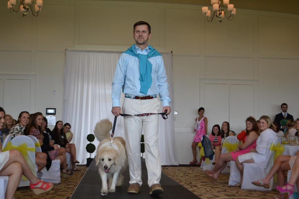 SUA Principal Mr. Maliborski and his dog strut their stuff on the catwalk (get it???).
