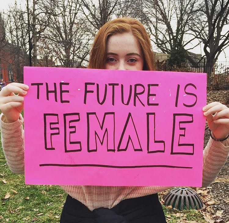 Margaret Lyon '18 holding her sign before the march.