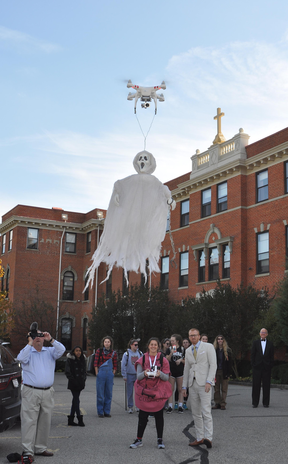Drone Club Co-President Lindsey Weber flying her Halloween surprise at lunchtime: a ghost suspended underneath her drone.