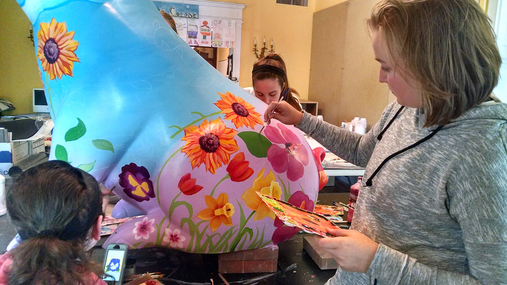 SUA's young artists busily work on Petunia's makeover.