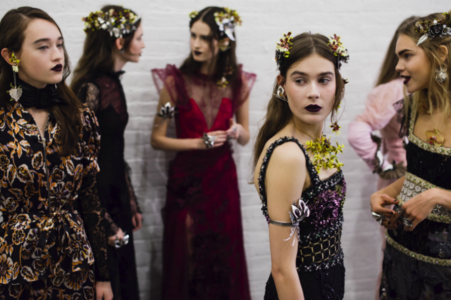 Rodarte Fall 2016 features grungy makeup to accompany the carefully detailed dresses and accessories.