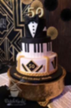 Tuxedo piano art deco birthday cake
