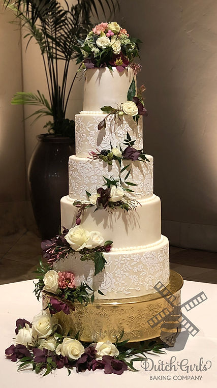 5 tier wedding cake with fresh flowers