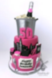 50th pink champagne skyline shopping birthday party cake