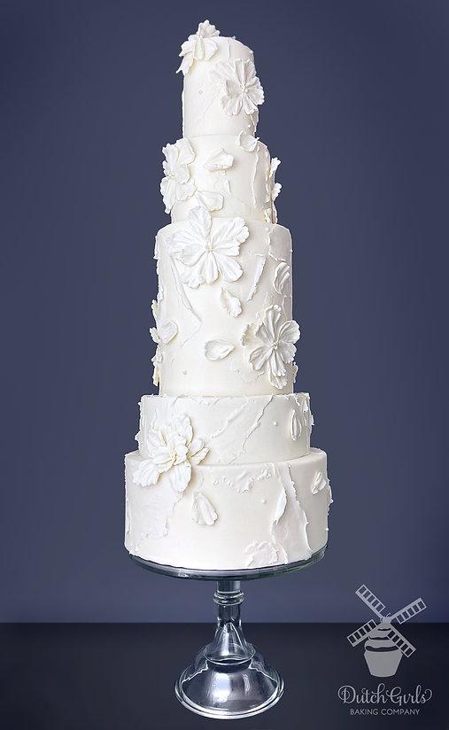 5 tier modern wedding cake with double barrel