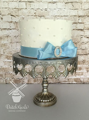 Elegant cake with blue ribbon