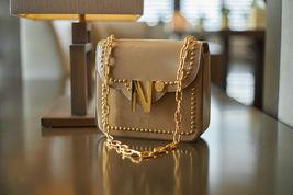 Cardinalno First Date Chaplet embellished beige caviar leather bag